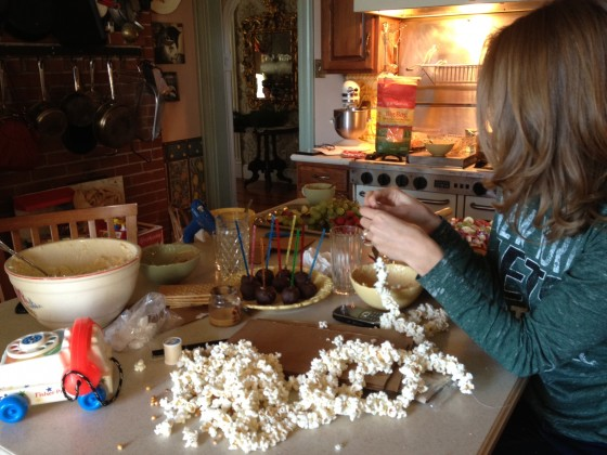 Hannah stringing popcorn while we're making the houses and listening to Christmas music