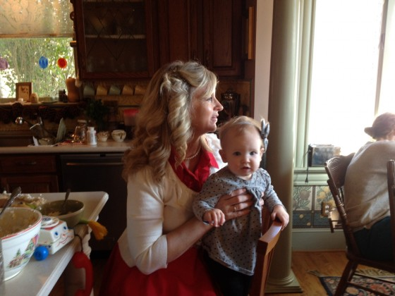 I get the privilege of holding Felicity while the gingerbread houses are being built!
