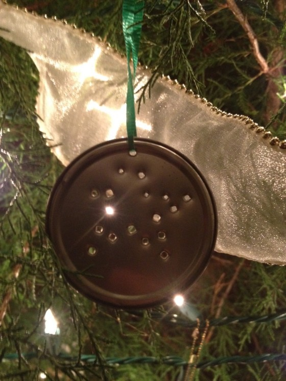 One of our daughters made this years ago- tin top with punched holes