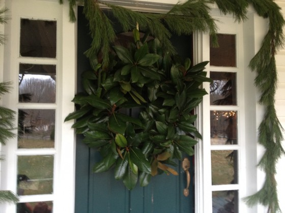 I hung it on a wreath hanger-- For years I didn't have one. Dale hammered a nail into top of my door. It poked up ever so slightly-- I wrapped thin wire around the nail and hung the wreath by the wire held up by the nail. It worked!