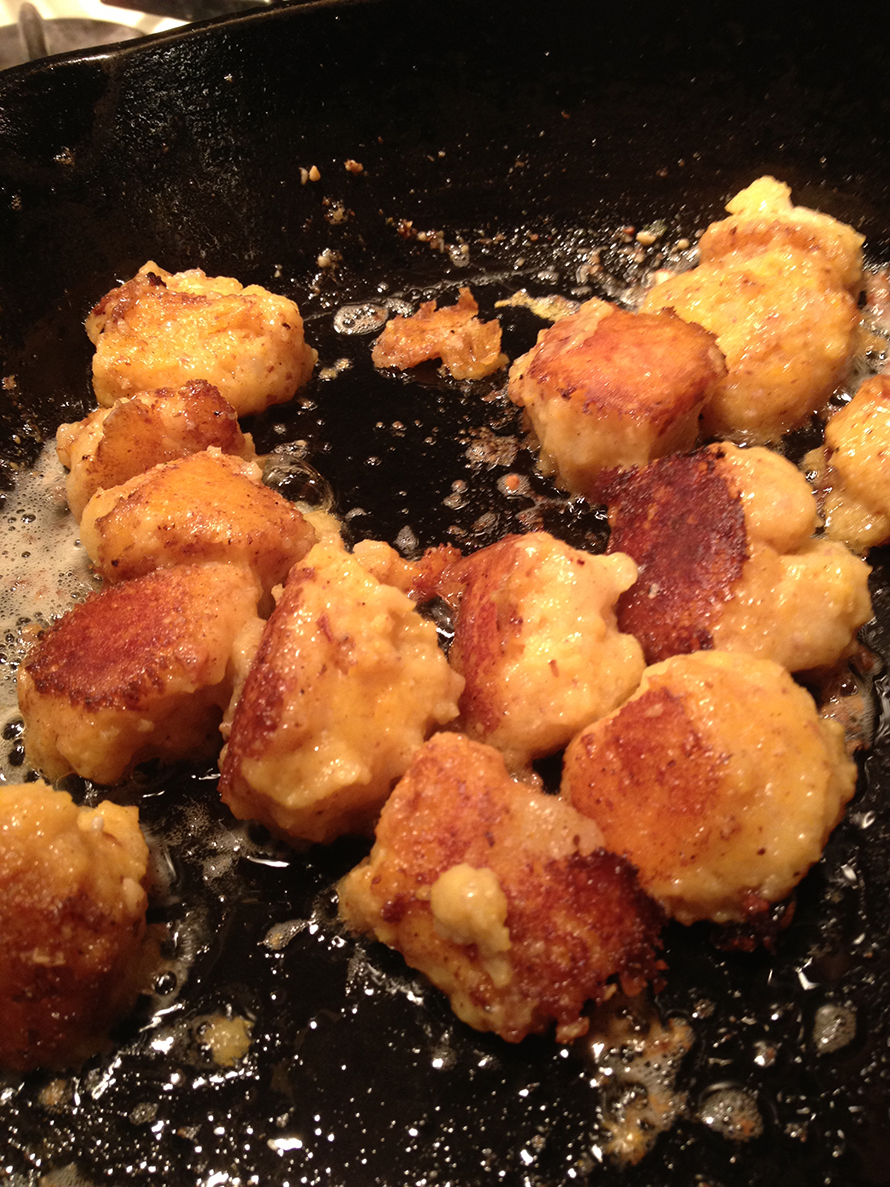 Frying gnocchi on medium high until brown on each side