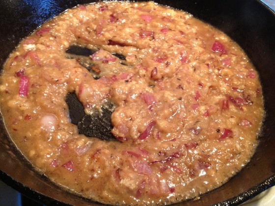 Add cider, broth and flour to onion and grease mixture, stir and turn off heat
