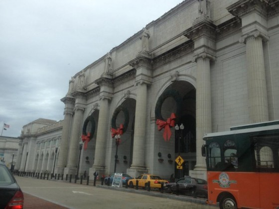 Union Station in the long line of cars