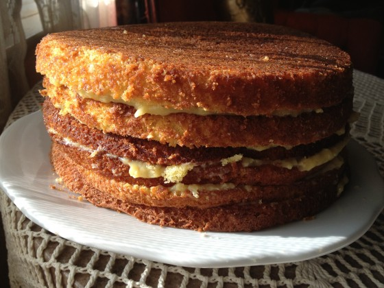 Keep stacking with a new layer of cake and filling