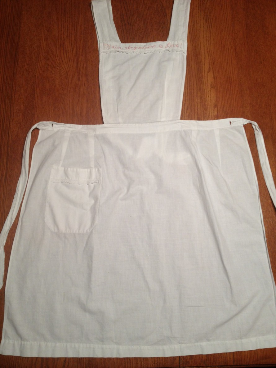 "The second winner drawn will win this vintage apron. Embordered at top of apron it says, "" Main Ingredient is Love"""