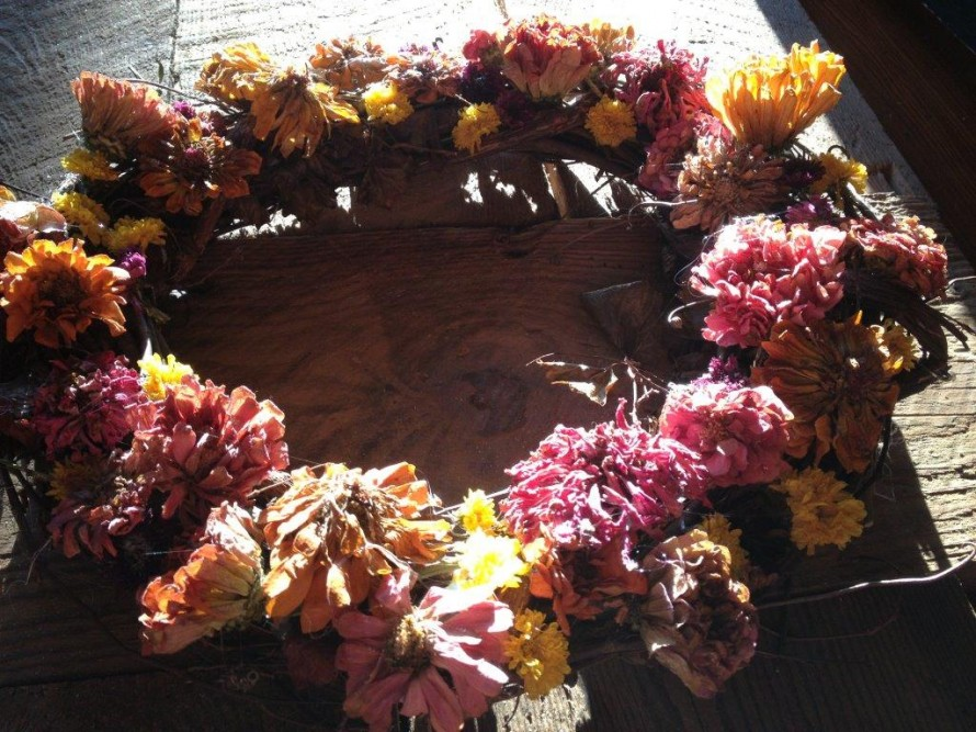 Use a glue gun to glue the dried flowers into place